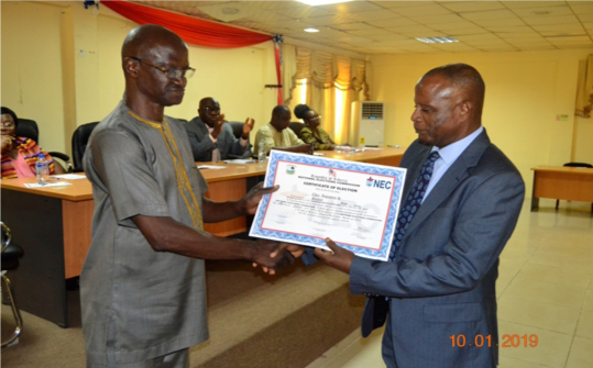 Commissioner Dukuly, Oversight for Sinoe County Presents Certificate to Senator Elect Cllr. Chea.